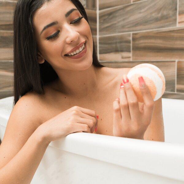 model holding bath bomb
